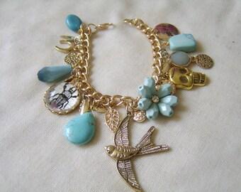 Loaded Charm Bracelet . Eclectic Charm Bracelet . Vintage Style Charm Bracelet With A Modern Twist. Skull Charm,Horseshoe ,Swallow Charms. .