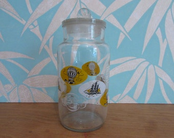 circa 1960s glass cookie jar, illustrated with balloon airships, & schooners/ships; around the world in eighty days