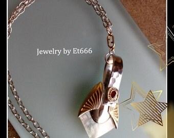 Jewelry designer pendant. Louise Brooks