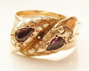 A 1915 Purple Amethyst And Nine Carat Rose Gold Snake Ring