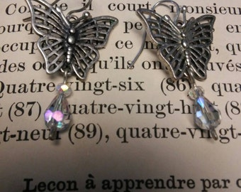 Lovely silver butterfly dangle earrings with sparkly crystal accents