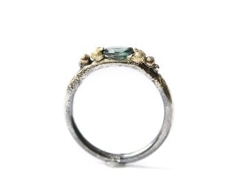 Mixed metal (engagement) ring with green tourmaline