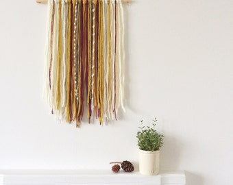 Wall hanging in Mustard yellow and raspberry pink