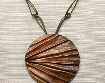Hand forged and patinated copper pendant, foldforming, protective wax, round, diameter 6 cm