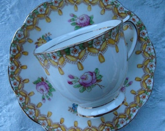"Royal Albert Bone China England ""Torquay"" Yellow - Vintage Tea Cup and Saucer -  Floral Rim, Scalloped, Yellow Swags"