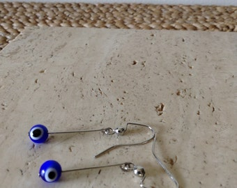 The Lucky Eye or Evil Eye bead is an amulet that Turkish people believe it protects against the Evil Eye. Dangle earrings.