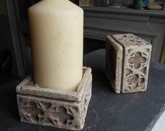 Candle block holder, stone effect,gothic quatrefoil design, a pair of.