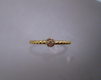 Woman's 18K yellow and white gold midi ring with a genuine brown zircon. Great for stacking or as a delicate engagement ring.