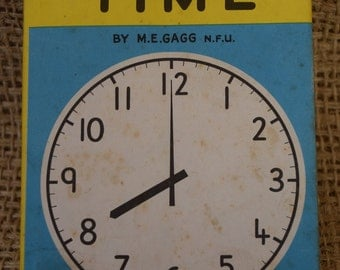Telling the Time. A Vintage Ladybird Learning to Read Book. First Edition. Dust Jacket and Unclipped. 1962