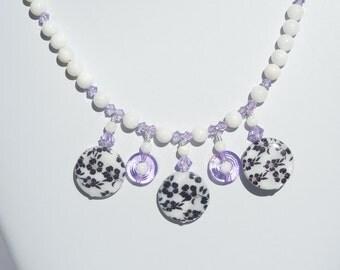 Black/white/violet shell necklace with Swarovski violet crystals