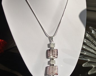 Beaded pendant with interchangeable bead post.