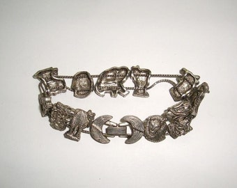 "African safari slide bracelet with lions, tigers and elephants, zebras, giraffes and birds. About 7.5"" long. In good used condition."