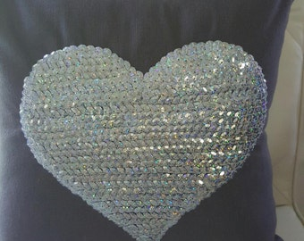 luxury bedroom cushion with sequinned heart detail