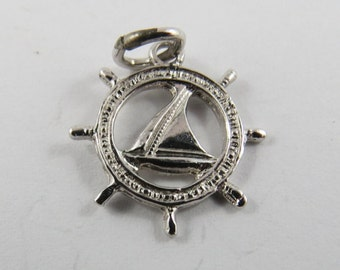 Boat Steering Wheel or Helm With Sailboat in the Center Sterling Silver Charm of Pendant.