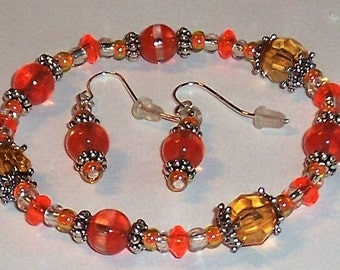 Orange and Topaz Bracelet with Silverl Caps and Spacers. Free Shipping