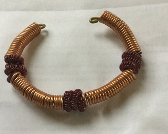 Copper wire wrapped bracelet with red wire accents