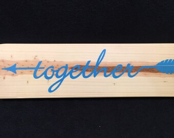 Together arrow sign