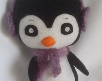 Penguin with ear muffs