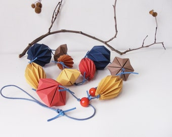Garland origami paper, decorative wall, blue, ochre and brick.