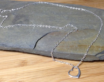 A 925 sterling silver chain and heart charm necklace.