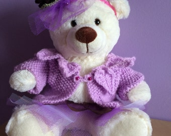 Cute Teddy Bear in a fascinator, knitted cardigan and tutu