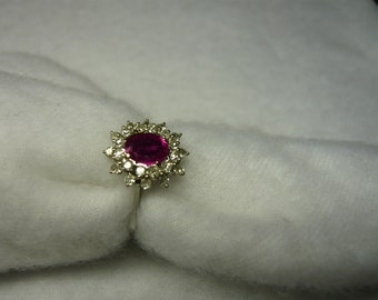 18 ct white gold ring with natural diamonds and Burmese Ruby.