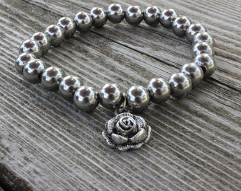 Stainless steel bracelet with charm