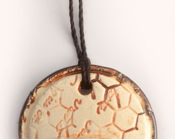 ceramic pendant necklace stamped with huh & honeycomb