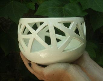 White ceramic vase carved by hand.