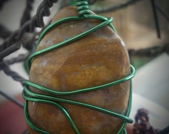 Wire wrapped polished stone
