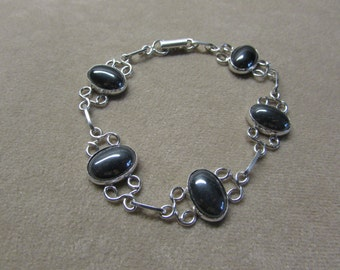 Exquisite HEMETITE STERLING silver 6 stone bracelet with lace wire work.