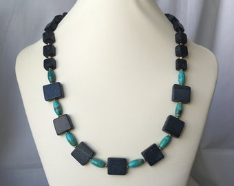"""Turquoise and Blackstone 18"""" Beaded Necklace with Gold Accents and Toggle Clasp"""