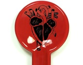spoon rest with an anatomical heart print, shown in Berry Red - Made to Order / Pick Your Colour