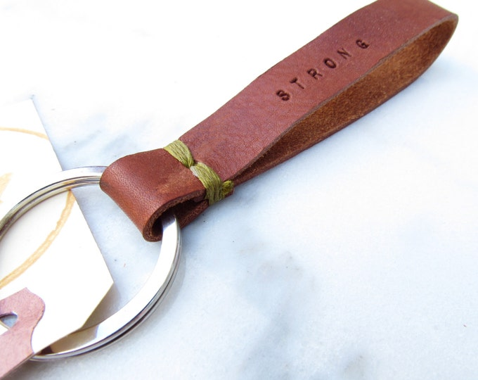 "Clearance Sale: **READY TO SHIP** ""Strong"" Stitch Leather Keychain."