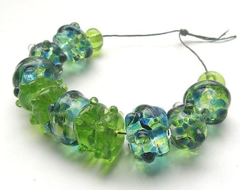 artisan lampwork, handmade  -  pretty summergreen with little blue and different shapes  - by Calisto