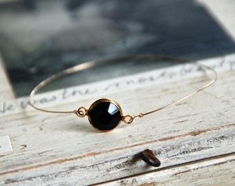 Vintage black channel set lucite stone bangle,rhinestone bangle,rhinestone bracelet. Tiedupmemories