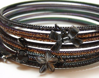 Dark Lolita Charm Bangles - Eight black, purple, and copper glitter metal bangles with bow, flower, and rhinestone charms