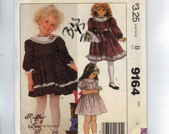1980s Girls Vintage Sewing Pattern McCalls 9164 Girls Ruffles and Lace Full Skirt Party Dress Size 4 Breast 23 1984 80s  UNCUT