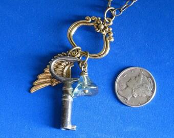 Necklace melange Vintage skeleton key Antique brass wing stamping Glass blue green iridescent flower Floral antiqued brass connector