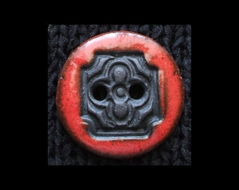 Handmade Ceramic Button: Flower Motif in Black Basaltic Stoneware and Hot Red
