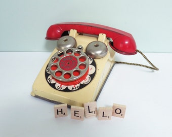 Vintage Pla-Phone Toy Telephone with Rotary Dial, Yellow and Red Metal by The Gong Bell Mfg. Co.