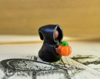 Black Mage with Pumpkin Figurine