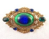 RESERVED for Carol =============== Antique Foil Glass Peacock Eye Ornate Brass Brooch