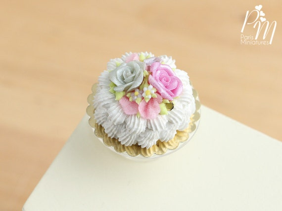 Cream Cake Decorated With Roses Blossoms And Pink Rose Petals