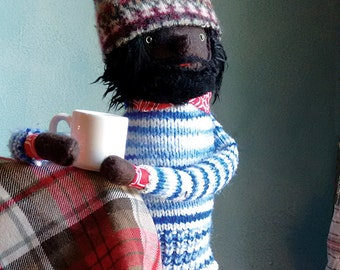 Brown skinned hipster man doll in striped sweater and hat
