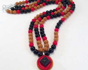 Stacked  button pendant on double strand of lucite beads
