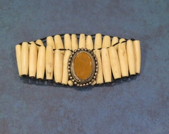 Bracelet Made of Horn Tubes - Elastic Bound - Accent Bead Bezel Set Rich Carmel - Bezel has Mill Work and Bead Work