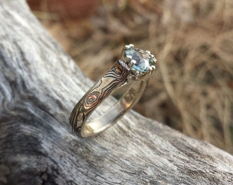 Custom mokume gane engagment solitare with unique setting