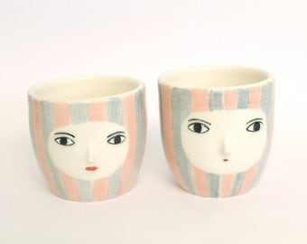 Pair of handless cups / ceramic glasses - high relief face