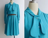 50% OFF - Vintage 80's Turquoise Pussy Bow Textured Dot Secretary Dress L or XL